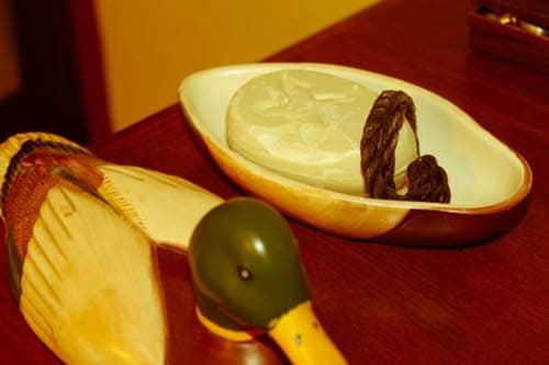 Vintage treasure box and mallard soap placed at table illustration.
