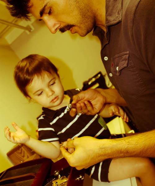 Vintage man and little child pop pop's old pocket knife.
