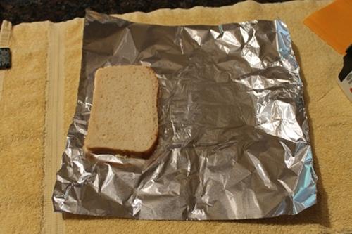 Vintage tear off a piece of foil that is big enough to wrap your sandwich.