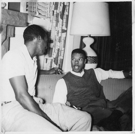 Vintage african american black men having conversation on couch.