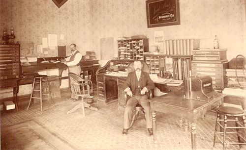 vintage businessmen in large office at desks