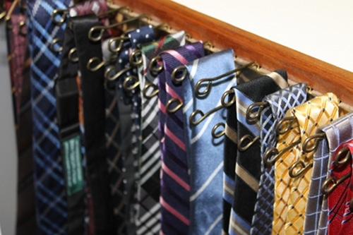 tie rack in closet close up photo