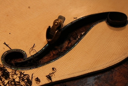 Carving design on guitar wood panel.