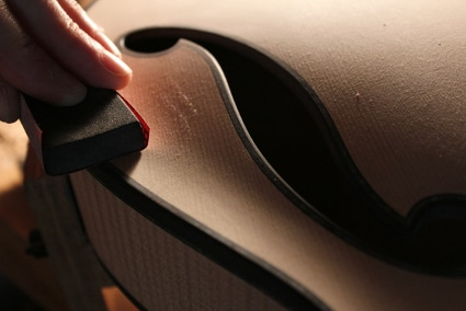 Polishing guitar surface.