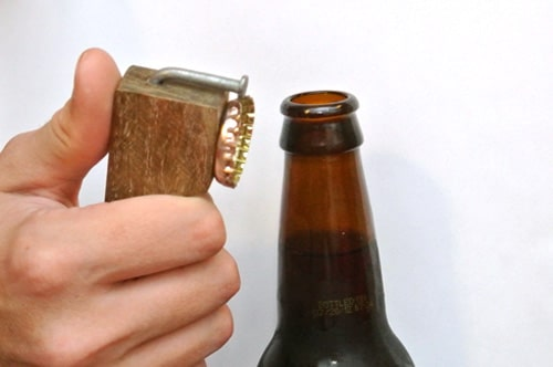 Redneck bottle opener out of a nail and scrap wood.