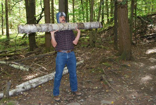 Vintage man hoist log to the top of his chest.