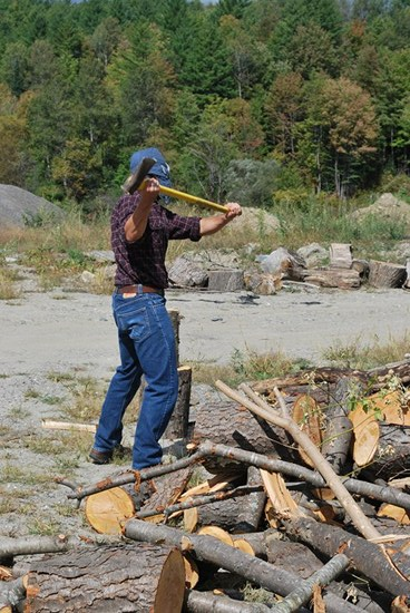Vintage man placing his log on a larger log.