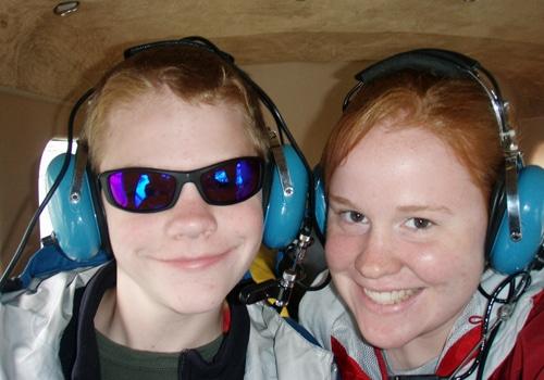 Boy and girl wearing headphones.