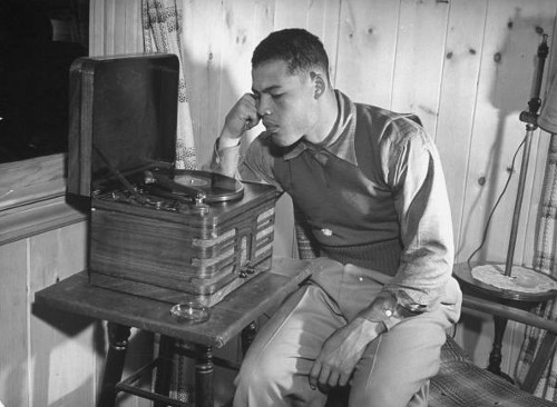 Vintage Joe Louis boxer listening to records turntable.