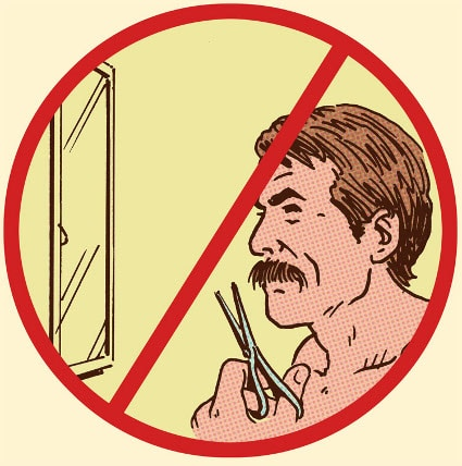 man trimming handlebar mustache in front of mirror don't sign