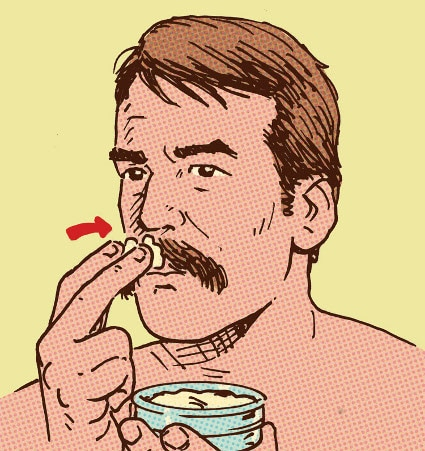 man applying mustache wax to facial hair illustration