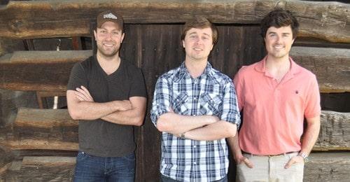 Matt, Colin, & Charlie standing against wall.