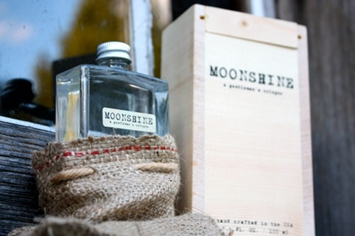 moonshine cologne bottle in bag wooden box