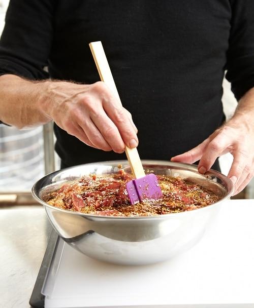 homemade beef jerky seasoning meat in large bowl