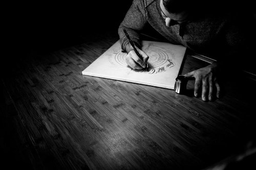 Master Penman Jake Weidmann making drawing in studio.