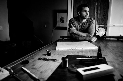jake weidmann master penman at desk black white photo
