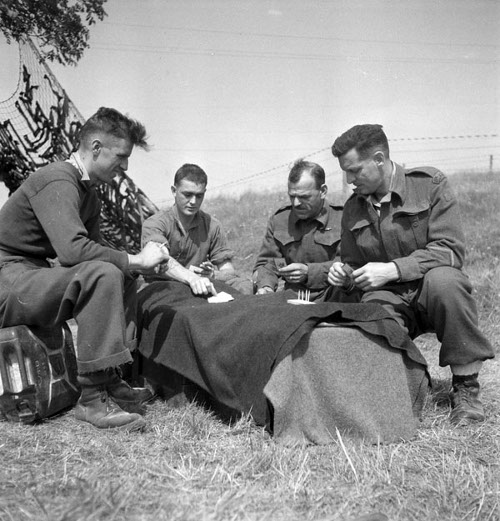 vintage men playing cribbage outside in field