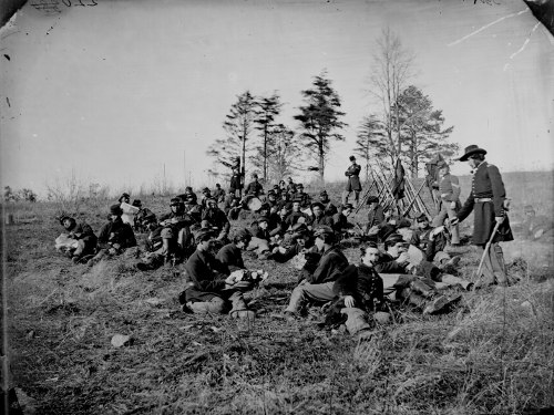 North civil war soldiers sitting in fields.