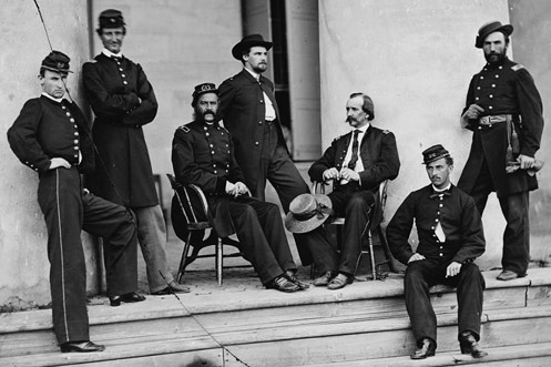 Union army civil war officers sitting and standing on stairs steps.
