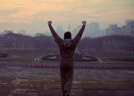 rocky balboa stair workout arms raised victory