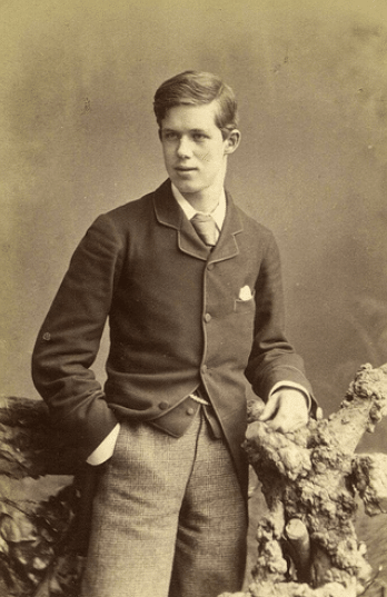 Vintage upper class young man portrait wearing trousers and vest.