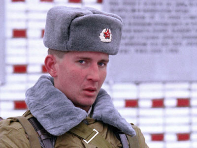 Soviet soldier wearing gray ushanka winter hat