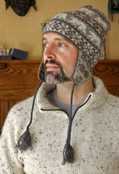 man wearing knife stocking cap with tassels