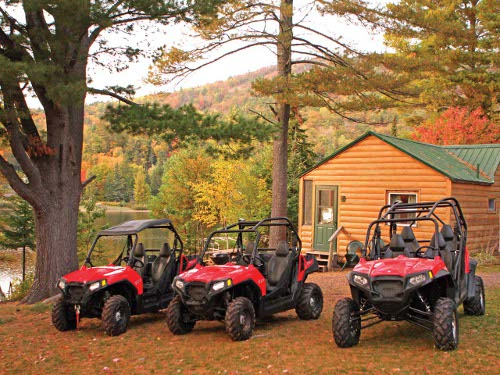 red ATVs near lake and cabin in Upper Peninsula, Michigan
