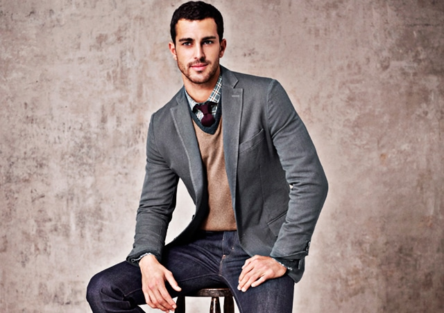 male model with layers blazer vest button up shirt