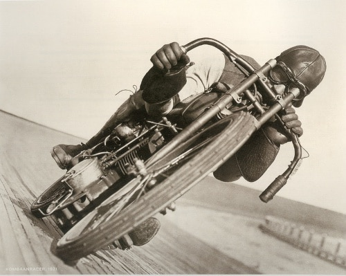 vintage young man on motorcycle on race track
