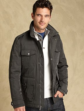 Male model wearing jacket layer and button up shirt.