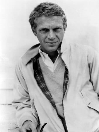 steve mcqueen cool look with layers holding tobacco pipe