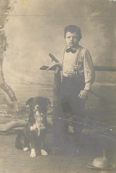 Jack London in 1885, at age 9. posing with dog