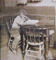 Young Jack London studying the dictionary at J.M. Heinold's Saloon