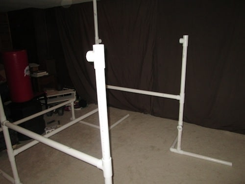 Step 13: Insert a two foot PVC pipe into the top of the T section and another T section on top of that. Make sure it is pointed inward.