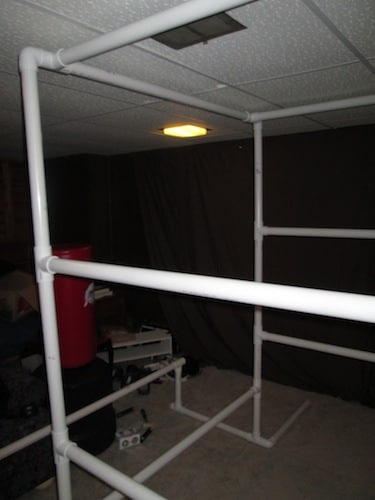 Step 19: Insert your 4 foot 3 inch section into the open T section holes above the parallel bars.