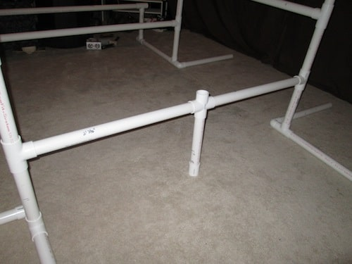 Step 21: Insert your 2 foot 3 1/2 inch PVC pipes on both sides of the cross section as shown below.