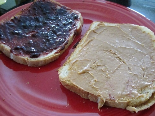 I buttered one side of the bread (for grilled cheese-style grilling), then flipped over and gave one piece jam and the other piece peanut butter.