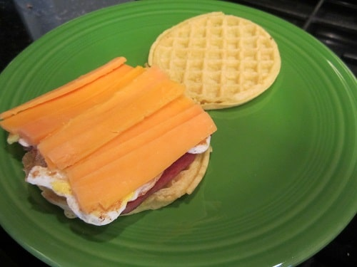 Vintage adding Cheese into waffles.