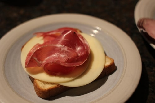 Vintage bread and capicola on a plate.