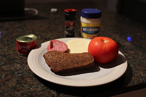 Vintage rye bread, butter, salami Ingredients.