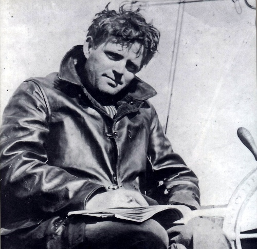 jack london sitting writing in notebook on yacht