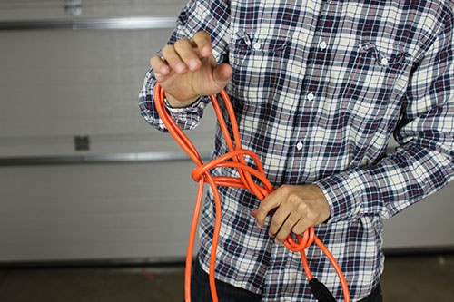 Vintage wrap extension cord pull strands through the loop.