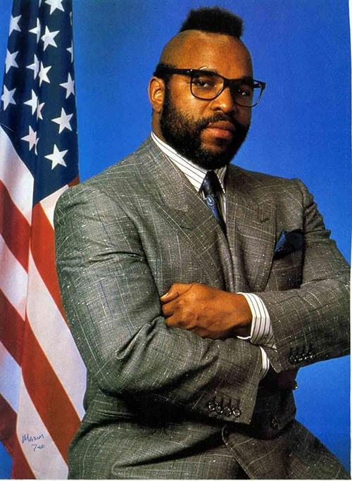 Mr. T wearing suit american flag behind.