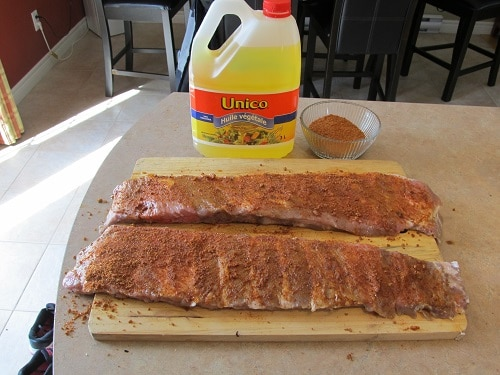 applying dry rub to homemade bbq barbecue pork ribs