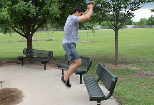 Vintage man jumping on the bench.