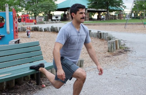 Vintage man doing Bulgariansplit squat exercise.