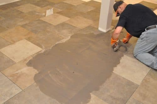 spreading grout across tile floors