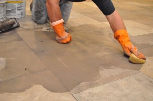 Vintage Sponging tile joints fresh grout.