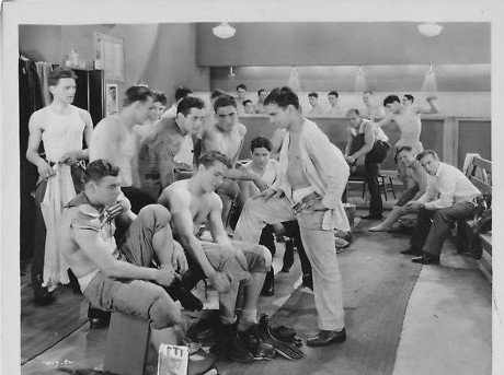 Vintage locker room young men getting changed.